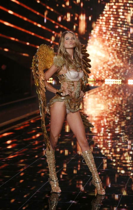 Model Doutzen Kroes displays a creation at the Victoria's Secret fashion show in London, Tuesday, Dec. 2, 2014. (Photo by Joel Ryan/Invision/AP)